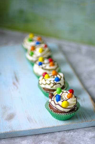 chocolate cupcakes in green paper forms