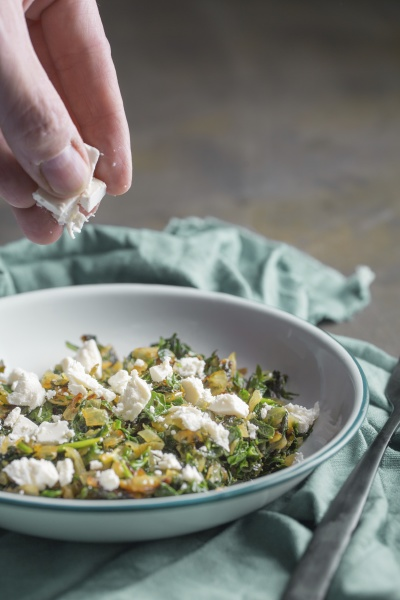 a cook making stuffing for spanakopita