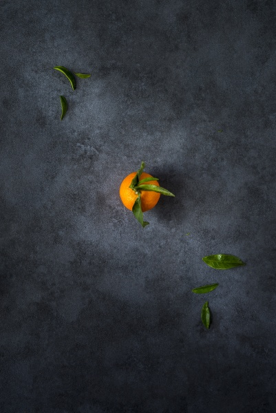 a mandarin with leaves on a