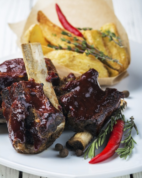 glazed ribs with baked potatoes
