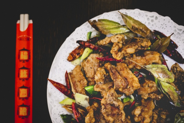 cooked appetizing spicy lamb with cucumber