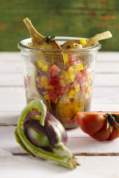 young pickled artichokes with tomatoes