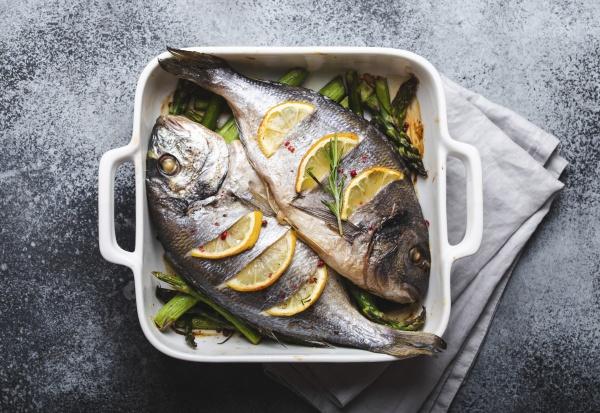baked fish dorado with green asparagus