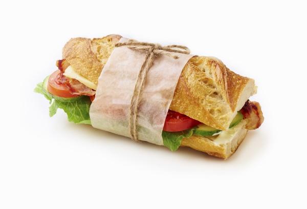 fresh big baguette sandwich with bacon