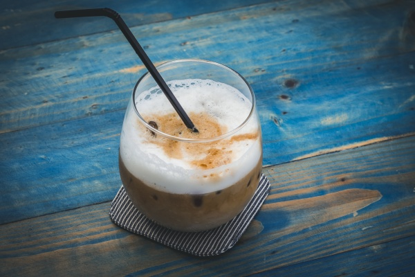 iced latte on a blue wooden