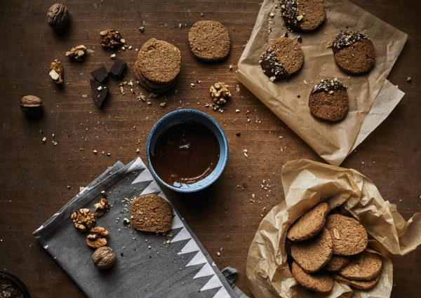 walnut cookies dipped in melted chocolate