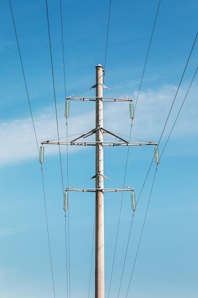 high voltage line pillar against blue