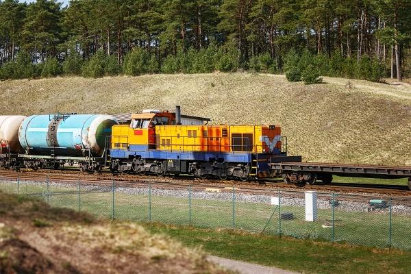cargo yellow locomotive with tanks