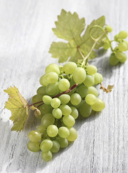 green grapes on a wooden background