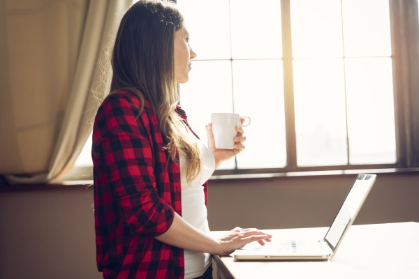 woman teleworker works at home with