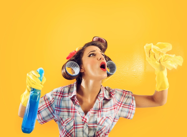 girl housewife with gloves and spray