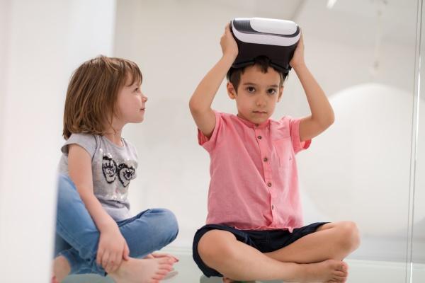 kids using virtual reality headsets at