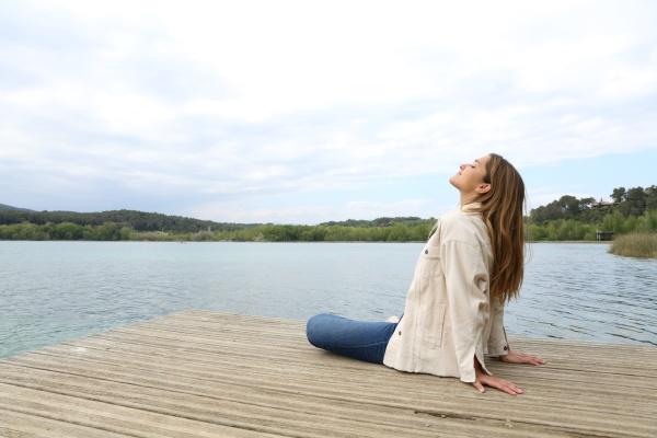 woman sitting in a pier breathing