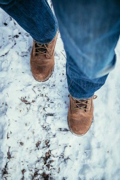 man is walking on snow wintertime