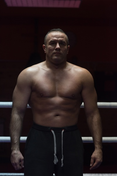 portrait of muscular professional kickboxer