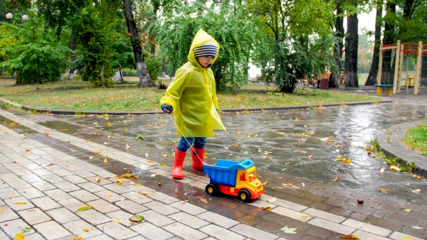 cute little boy in raincoat and