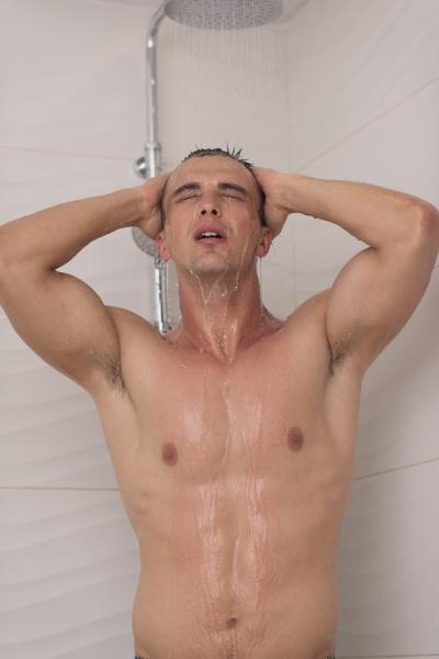 man taking shower in bath
