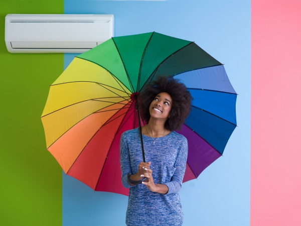 young black woman holding a colorful