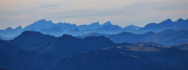 silhouettes of mountains in the swiss