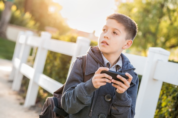 concerned young hispanic boy walking with