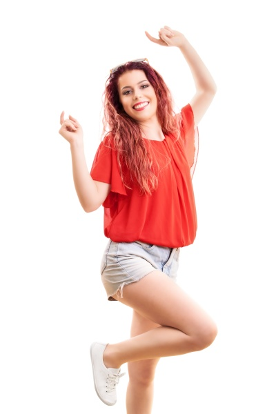 beautiful redhead jumping from happiness