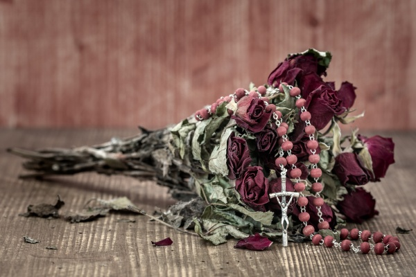bouquet of faded roses with catholic