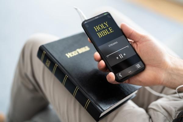 preacher listening bible on phone