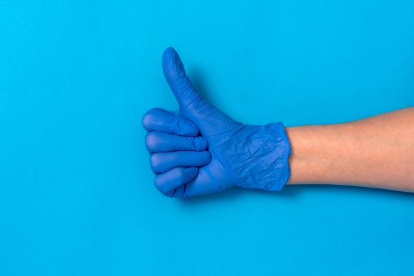 hand in a blue rubber glove