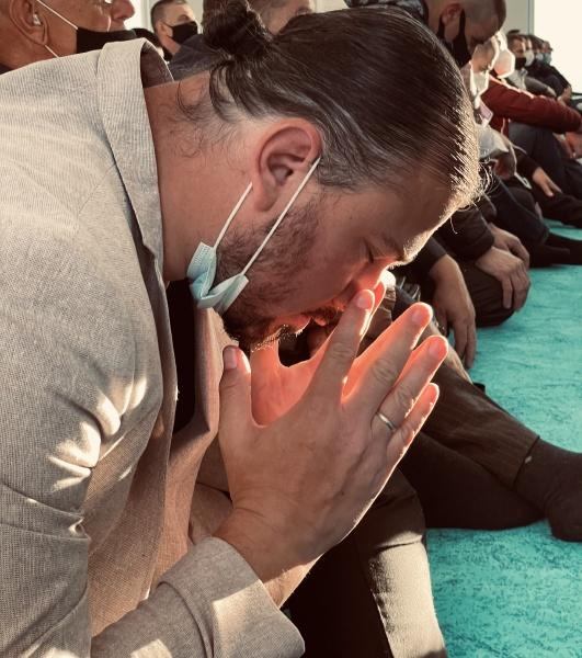 dark tone muslim man praying with