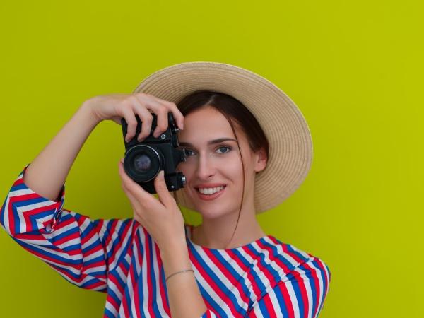 portrait of beautiful female photographer shooting
