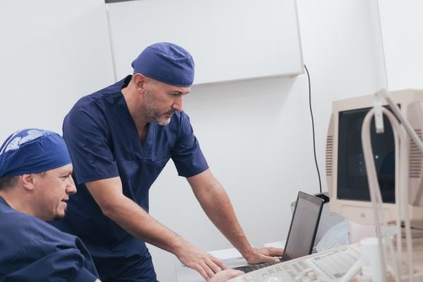 orthopedist doctor team examining digital x