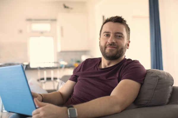 portrait confident man working from home