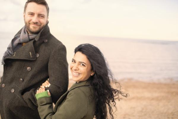 portrait happy carefree couple on winter