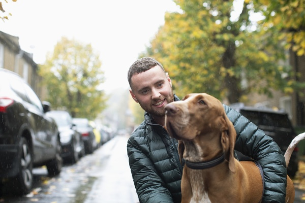 happy young man with dog on