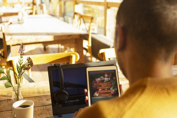 male restaurant owner reviewing online delivery