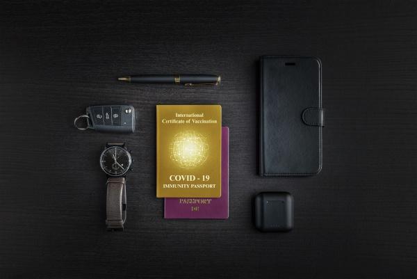 covid 19 immunity passport on table
