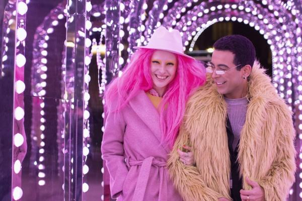 portrait fashionable couple under illuminated arch