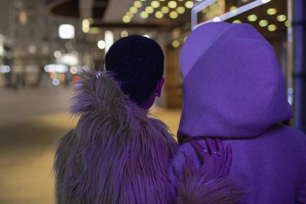 couple on dark city sidewalk