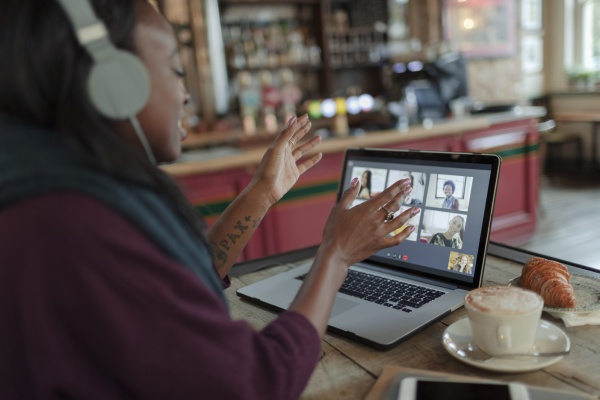 woman video conferencing with colleagues at