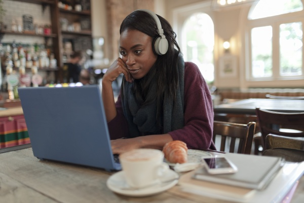 young businesswoman with headphones working at