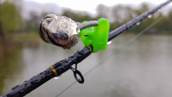 silver fishing bells are worn on