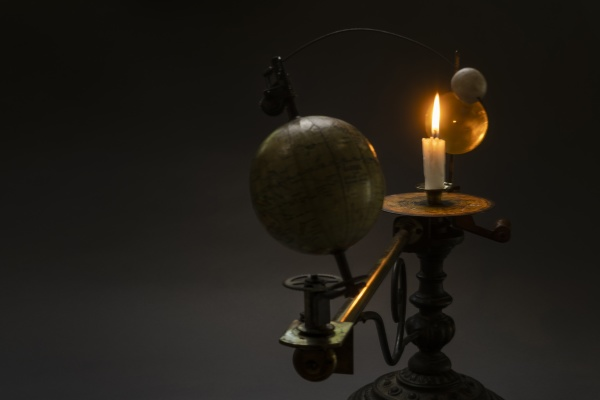 antique globe and candle solar system