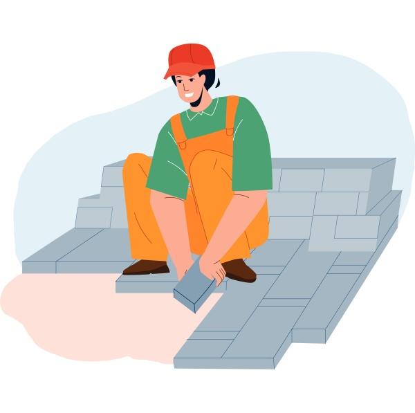 granite worker laying street stone pavers