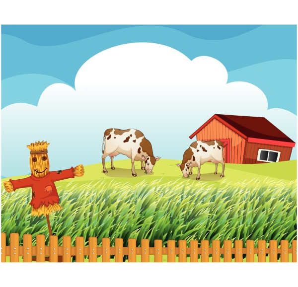 a scarecrow with two cows inside