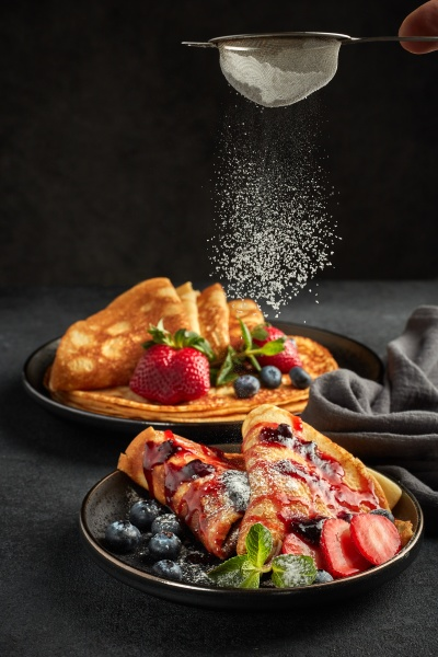 pancakes with berries and sweet sauce