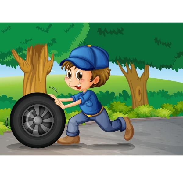 a boy wearing a cap pushing