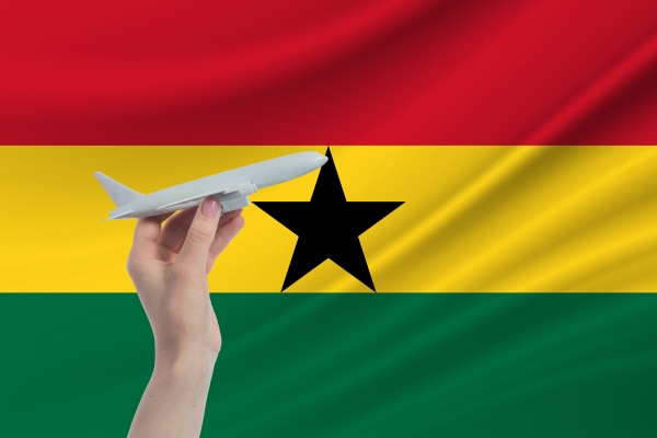 airplane in hand with national flag