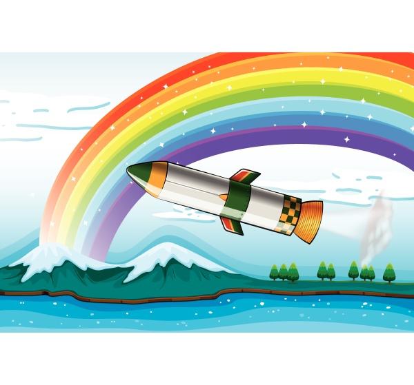 a rainbow above the ocean and
