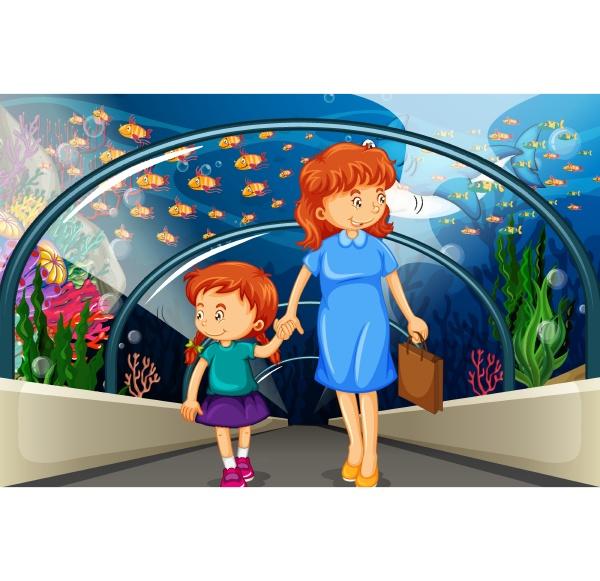 mother and kid at the aquarium