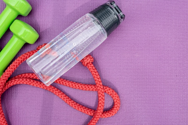 ladies dumbbells water bottle and skipping